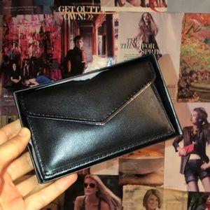 Brand new Bloomingdales change/credit card holder